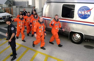 KENNEDY SPACE CENTER, Fla. -- The STS-108 and Expedition 4 crews head for the Astrovan and a ride to Launch Pad 39B. Leading the way are Pilot Mark E. Kelly (left) and Commander Dominic L. Gorie; behind them are Mission Specialists Daniel M. Tani and Linda A. Godwin; next is Expedition 4 Commander Yuri Onufrienko, followed by astronauts Daniel W. Bursch (left) and Carl E. Walz. This is the second launch attempt after the first attempt Dec. 4 was scrubbed due to poor weather conditions at KSC. The main goals of the mission are to carry the Expedition 4 crew to the International Space Station as replacement for Expedition 3; carry the Multi-Purpose Logistics Module Raffaello filled with water, equipment and supplies; and install thermal blankets over equipment at the base of the ISS solar wings. STS-108 is the final Shuttle mission of 2001 and the 107th Shuttle flight overall. Launch is scheduled for 5:19 p.m. EST (22:19 GMT) Dec. 5, 2001, from Launch Pad 39B