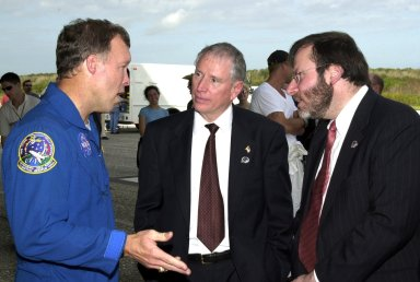 KENNEDY SPACE CENTER, FLA. -- After a successful landing at the KSC Shuttle Landing Facility, completing mission STS-108, Commander Dominic L. Gorie (left) talks with Acting NASA Administrator Daniel Mulville (center) and White House liaison Courtney Stadd. Endeavour carried both the mission crew and the Expedition 3 crew -- Commander Frank Culbertson and cosmonauts Vladimir Dezhurov and Mikhail Tyurin -- who returned to Earth after 129 days on the International Space Station. Completing a mission-elapsed time of 11 days, 19 hours and 35 minutes, Endeavour had main gear touchdown at 12:55:10 p.m. EST (17:55:10 GMT). Nose gear touchdown occurred at 12:55:23 p.m. (17:55:23 GMT); wheel stop at 12:56:13 p.m. (17:56:13 GMT). Rollout distance was 8,941 feet. The landing is the 57th at KSC in the history of the program STS-108 was the 12th mission to the Space Station. This mission was the 107th flight in the Shuttle program and the 17th flight for the orbiter
