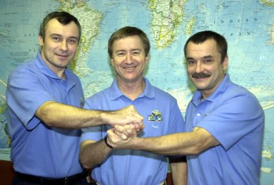 KENNEDY SPACE CENTER, FLA. -- The Expedition 3 crew do a group handshake one day after their return to Earth from their 129-day stay on the International Space Station. From left are Vladimir Dezhurov, Frank Culbertson and Mikhail Tyurin. They returned as passengers aboard the orbiter Endeavour, which landed at KSC at 12:55 p.m. EST (17:55 GMT) Dec. 17, 2001, after completing mission STS-108. The landing is the 57th at KSC in the history of the program STS-108 was the 12th mission to the Space Station. This mission was the 107th flight in the Shuttle program and the 17th flight for the orbiter