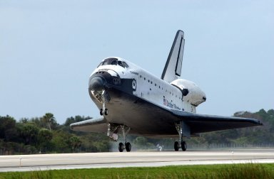 KENNEDY SPACE CENTER, FLA. -- Orbiter Endeavour touches down on Runway 15 at the KSC Shuttle Landing Facility, completing mission STS-108. After a mission-elapsed time of 11 days, 19 hours and 35 minutes, the landing is the 57th at KSC in the history of the program. Main gear touchdown occurred at 12:55:10 p.m. EST (17:55:10 GMT), nose gear touchdown at 12:55:23 p.m. (17:55:23 GMT) , wheel stop at 12:56:13 p.m. (17:56:13 GMT). STS-108 was the 12th mission to the International Space Station. This mission was the 107th flight in the Shuttle program and the 17th flight for the orbiter. Endeavour carries both the mission crew and the Expedition 3 crew - Commander Frank Culbertson and cosmonauts Vladimir Dezhurov and Mikhail Tyurin - who are returning to Earth after 129 days in space on the Space Station