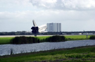 KENNEDY SPACE CENTER, FLA. -- Orbiter Endeavour appears to head toward the Vehicle Assembly Building (background) as it approaches touchdown on Runway 15 at the KSC Shuttle Landing Facility, completing mission STS-108. After a mission-elapsed time of 11 days, 19 hours and 35 minutes, the landing is the 57th at KSC in the history of the program. Main gear touchdown occurred at 12:55:10 p.m. EST (17:55:10 GMT), nose gear touchdown at 12:55:23 p.m. (17:55:23 GMT) , wheel stop at 12:56:13 p.m. (17:56:13 GMT). STS-108 was the 12th mission to the International Space Station. This mission was the 107th flight in the Shuttle program and the 17th flight for the orbiter. Endeavour carries both the mission crew and the Expedition 3 crew - Commander Frank Culbertson and cosmonauts Vladimir Dezhurov and Mikhail Tyurin - who are returning to Earth after 129 days in space on the Space Station