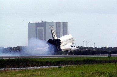 KENNEDY SPACE CENTER, FLA. - Dust streams behind orbiter Endeavour as it touches down on Runway 15 at the Shuttle Landing Facility, completing mission STS-108 after a mission-elapsed time of 11 days, 19 hours and 35 minutes. The landing is the 57th at KSC in the history of the program. Main gear touchdown occurred at 12:55:10 p.m. EST (17:55:10 GMT), nose gear touchdown at 12:55:23 p.m. (17:55:23 GMT) , wheel stop at 12:56:13 p.m. (17:56:13 GMT). STS-108 was the 12th mission to the International Space Station. This mission was the 107th flight in the Shuttle program and the 17th flight for the orbiter. Endeavour carries both the mission crew and the Expedition 3 crew - Commander Frank Culbertson and cosmonauts Vladimir Dezhurov and Mikhail Tyurin - who are returning to Earth after 129 days in space on the Space Station