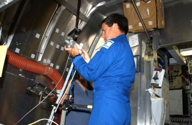 KENNEDY SPACE CENTER, FLA. -- STS-107 Payload Specialist Ilan Ramon checks equipment during crew training at SPACEHAB, Cape Canaveral, Fla. STS-107 is a research mission, and the primary payload is the first flight of the SHI Research Double Module (SHI/RDM). The experiments range from material sciences to life sciences (many rats). Among the experiments is a Hitchhiker carrier system, modular and expandable in accordance with payload requirements. STS-107 is scheduled to launch in June 2002.