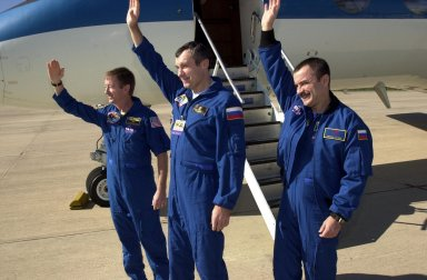 KENNEDY SPACE CENTER, FLA. -- The Expedition Three crew wave farewell before boarding the plane for Houston. From left to right are Commander Frank Culbertson and cosmonauts Vladimir Dezhurov and Mikhail Tyurin. The three returned to Earth, and KSC, as passengers aboard the orbiter Endeavour, which landed at 12:55 p.m. EST (17:55 GMT) Dec. 17, 2001, after completing mission STS-108. Expedition 3 had spent 129 days on the International Space Station. The landing is the 57th at KSC in the history of the program STS-108 was the 12th mission to the Space Station. This mission was the 107th flight in the Shuttle program and the 17th flight for the orbiter