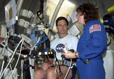 KENNEDY SPACE CENTER, FLA. - STS-107 Payload Specialist Ilan Ramon, from Israel, pauses during an experiment at SPACEHAB, Cape Canaveral, Fla., to talk with Mission Specialist Laurel Clark. STS-107 is a research mission. The primary payload is the first flight of the SHI Research Double Module (SHI/RDM). The experiments range from material sciences to life sciences (many rats). Also part of the payload is the Fast Reaction Experiments Enabling Science, Technology, Applications and Research (FREESTAR) that incorporates eight high priority secondary attached shuttle experiments: Mediterranean Israeli Dust Experiment (MEIDEX), Shuttle Ozone Limb Sounding Experiment (SOLSE-2), Student Tracked Atmospheric Research Satellite for Heuristic International Networking Experiment (STARSHINE), Critical Viscosity of Xenon-2 (CVX-2), Solar Constant Experiment-3 (SOLOCON-3), Prototype Synchrotron Radiation Detector (PSRD), Low Power Transceiver (LPT), and Collisions Into Dust Experiment -2 (COLLIDE-2). STS-107 is scheduled to launch in July 2002.