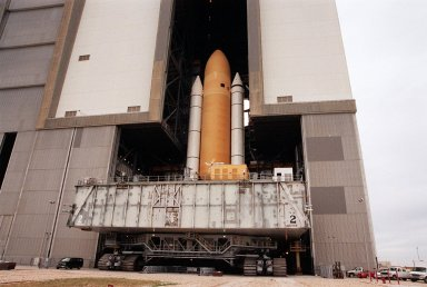 KENNEDY SPACE CENTER, FLA. -- Space Shuttle Atlantis moves back inside the Vehicle Assembly Building after an aborted rollout to Launch Pad 39A. Atlantis will fly on mission STS-98, the seventh construction flight to the International Space Station. The orbiter will carry in its payload bay the U.S. Laboratory, named Destiny, that will have five system racks already installed inside the module. After delivery of electronics in the lab, electrically powered attitude control for Control Moment Gyroscopes will be activated. Atlantis is scheduled for launch no earlier than Jan. 19, 2001, with a crew of five