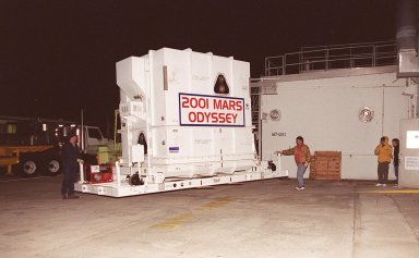 The 2001 Mars Odyssey spacecraft arrives at the Spacecraft Assembly and Encapsulation Facility 2 (SAEF-2) located in the KSC Industrial Area. The spacecraft arrived at KSC's Shuttle Landing Facility aboard an Air Force C-17 cargo airplane that brought it from Denver, Colo.., location of the Lockheed Martin plant where the spacecraft was built. In the SAEF, Odyssey will undergo final assembly and checkout. This includes installation of two of the three science instruments, integration of the three-panel solar array, and a spacecraft functional test. It will be fueled and then mated to an upper stage booster, the final activities before going to the launch pad. Launch is planned for April 7, 2001 the first day of a 21-day planetary window. Mars Odyssey will be inserted into an interplanetary trajectory by a Boeing Delta II launch vehicle from Pad A at Complex 17 at the Cape Canaveral Air Force Station, Fla. The spacecraft will arrive at Mars on Oct. 20, 2001, for insertion into an initial elliptical capture orbit. Its final operational altitude will be a 250-mile-high, Sun-synchronous polar orbit. Mars Odyssey will spend two years mapping the planet's surface and measuring its environment