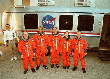 After walkout from the Operations and Checkout Building, the STS-98 [ http://mediaarchive.ksc.nasa.gov/../../subjects/sts-98.htm ] crew stops for a photograph in front of the Astrovan that will take them to Launch Pad 39A [ http://mediaarchive.ksc.nasa.gov/../../subjects/lc39a.htm ] for a simulated launch countdown. Standing left to right are Mission Specialists Thomas Jones and Robert Curbeam, Pilot Mark Polansky, Mission Specialist Marsha Ivins and Commander Ken Cockrell. The crew has been taking part in Terminal Countdown Demonstration Test activities, which include the simulated countdown and emergency egress training at the pad. STS-98 is the seventh construction flight to the International Space Station, carrying as payload the U.S. Lab Destiny [ http://mediaarchive.ksc.nasa.gov/../../subjects/destiny.htm ], a key element in the construction of the ISS. Launch of STS-98 is scheduled for Jan. 19 at 2:11 a.m. EST