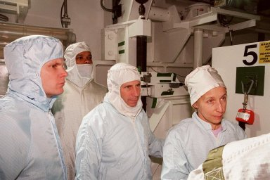 KENNEDY SPACE CENTER, FLA. -- Along with Scott Thurston (left), of the VITT office, members of the STS-98 crew Mission Specialist Robert Curbeam, Commander Ken Cockrell and Mission Specialist Marsha Ivins are in Atlantis? payload bay to check out their mission payload, the U.S. Lab Destiny. The crew is at KSC for Terminal Countdown Demonstration Test activities, which also include a simulated launch countdown. A key element in the construction of the International Space Station, Destiny is a pressurized module designed to accommodate pressurized payloads. It has a capacity of 24 rack locations. Payload racks will occupy 13 locations especially designed to support experiments. The module already has five system racks installed inside. Launch of STS-98 on its 11-day mission is scheduled for Jan. 19 at 2:11 a.m. EST