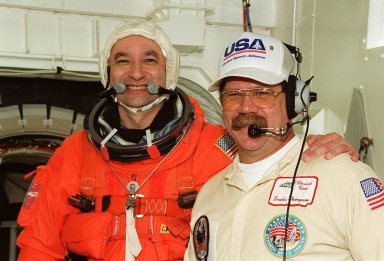 Before entering Atlantis from the White Room for a simulated launch countdown, STS-98 Pilot Mark Polansky (left) poses with Travis Thompson, who is the orbiter vehicle closeout chief. The White Room is an environmental chamber at the end of the orbiter access arm that mates with the orbiter to allow personnel to enter the orbiter?s crew compartment. Thompson is with United Space Alliance. The STS-98 crew is taking part in Terminal Countdown Demonstration Test activities, which also include emergency egress training at the pad. STS-98 is the seventh construction flight to the International Space Station, carrying as payload the U.S. Lab Destiny, a key element in the construction of the ISS. Launch of STS-98 is scheduled for Jan. 19 at 2:11 a.m. EST