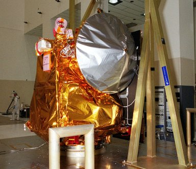 The 2001 Mars Odyssey Orbiter is safely placed on a workstand in the Spacecraft Assembly & Encapsulation Facility -2. The Mars Odyssey Orbiter carries three science instruments: the Thermal Emission Imaging System (THEMIS), the Gamma Ray Spectrometer (GRS), and the Mars Radiation Environment Experiment (MARIE). THEMIS will map the mineralogy and morphology of the Martian surface using a high-resolution camera and a thermal infrared imaging spectrometer. The GRS will achieve global mapping of the elemental composition of the surface and determine the abundance of hydrogen in the shallow subsurface. [The GRS is a rebuild of the instrument lost with the Mars Observer mission.] The MARIE will characterize aspects of the near-space radiation environment as related to the radiation-related risk to human explorers. The Mars Odyssey Orbiter is scheduled for launch on April 7, 2001, aboard a Delta 7925 rocket from Launch Pad 17-A, Cape Canaveral Air Force Station
