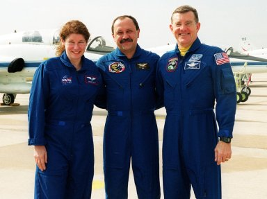 The three members of the Expedition Two crew arrive at KSC. Standing, left to right, are astronaut Susan Helms, cosmonaut Yury Usachev, and astronaut James Voss. They will be flying on mission STS-102 to the International Space Station, replacing the Expedition One crew, who will return to earth on Discovery. STS-102 will be Helms? and Voss?s fifth Shuttle flight, and Usachev?s second