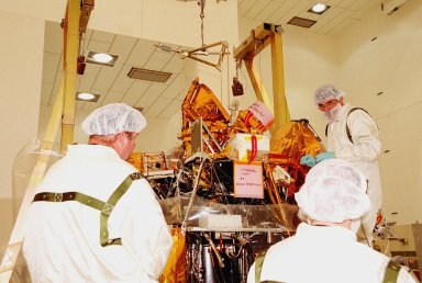 The Gamma Ray Spectrometer (GRS) is installed by technicians on the Mars Odyssey Orbiter in the Spacecraft Assembly and Encapsulation Facility 2 (SAEF 2).; The orbiter will carry three science instruments: the Thermal Emission Imaging System (THEMIS), the Gamma Ray Spectrometer (GRS), and the Mars Radiation Environment Experiment (MARIE). THEMIS will map the mineralogy and morphology of the Martian surface using a high-resolution camera and a thermal infrared imaging spectrometer. The GRS will achieve global mapping of the elemental composition of the surface and determine the abundance of hydrogen in the shallow subsurface. [The GRS is a rebuild of the instrument lost with the Mars Observer mission.] The MARIE will characterize aspects of the near-space radiation environment with regards to the radiation-related risk to human explorers. The Mars Odyssey Orbiter is scheduled for launch on April 7, 2001, aboard a Delta 7925 rocket from Launch Pad 17-A, Cape Canaveral Air Force Station