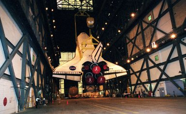 In the transfer aisle of the Vehicle Assembly Building the orbiter Discovery is suspended at an angle as it is lifted to a vertical position. It will next be lifted into high bay 1 for mating with its solid rocket boosters and external tank. Discovery will be launched March 8 on mission STS-102, the eighth construction flight to the International Space Station. The Shuttle will carry the Multi-Purpose Logistics Module Leonardo, the first of three pressurized modules provided by the Italian Space Agency to carry supplies and equipment to the Space Station and back to Earth