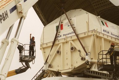 At the Shuttle Landing Facility [ http://mediaarchive.ksc.nasa.gov/../../subjects/slf.htm ], workers in cherry pickers (left and right) help direct the offloading of the Italian Space Agency?s Multi-Purpose Logistics Module [ http://mediaarchive.ksc.nasa.gov/../../subjects/mplm.htm ] Donatello from the Airbus ?Beluga? air cargo plane that brought it from the factory of Alenia Aerospazio in Turin, Italy. The third of three for the International Space Station, the module will be transported to the Space Station Processing Facility [ http://mediaarchive.ksc.nasa.gov/../../subjects/sspf.htm ] for processing. Among the activities for the payload test team are integrated electrical tests with other Station elements in the SSPF, leak tests, electrical and software compatibility tests with the Space Shuttle (using the Cargo Integrated Test equipment) and an Interface Verification Test once the module is installed in the Space Shuttle?s payload bay at the launch pad. The most significant mechanical task to be performed on Donatello in the SSPF is the installation and outfitting of the racks for carrying the various experiments and cargo
