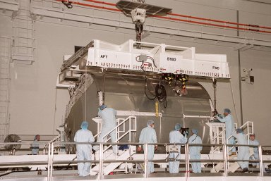 """In the Space Station Processing Facility, the Multi-Purpose Logistics Module Leonardo finally rests on the weight and balance scale. The Italian-built MPLM is one of three such pressurized modules that will serve as the International Space Station's """"moving vans,"""" carrying laboratory racks filled with equipment, experiments and supplies to and from the station aboard the Space Shuttle. The cylindrical module is approximately 21 feet long and 15 feet in diameter, weighing almost 4.1 metric tons. It can carry up to 9.1 metric tons of cargo packed into 16 standard space station equipment racks. The Leonardo will be launched on mission STS-102 March 8. On that flight, Leonardo will be filled with equipment and supplies to outfit the U.S. laboratory module, to be carried to the ISS on the Feb. 7 launch of STS-98"""
