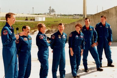 During Terminal Countdown Demonstration Test activities, the STS-102 crew takes time to talk to the media at the slidewire basket landing near Launch Pad 39B. From left to right are Commander James Wetherbee; Mission Specialists Yury Usachev, Andrew Thomas, James Voss, Susan Helms and Paul Richards; and Pilot James Kelly. Voss, Helms and Usachev are the Expedition Two crew who will be the second resident crew on the International Space Station. They will replace Expedition One, who will return to Earth with Discovery. STS-102 is the eighth construction flight to the International Space Station, with Space Shuttle Discovery carrying the Multi-Purpose Logistics Module Leonardo Launch on mission STS-102 is scheduled for March 8