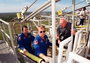 Getting training on the use of the slidewire basket for emergency exits from the launch pad are STS-102 Mission Specialists Paul Richards and Andrew Thomas. The rest of the crew includes Commander James Wetherbee, Pilot James Kelly and Mission Specialists James Voss, Susan Helms and Yury Usachev. The crew is taking part in Terminal Countdown Demonstration Test activities, which include a simulated launch countdown. STS-102 is the eighth construction flight to the International Space Station, with Space Shuttle Discovery carrying the Multi-Purpose Logistics Module Leonardo. Voss, Helms and Usachev are the Expedition Two crew who will be the second resident crew on the International Space Station. They will replace Expedition One, who will return to Earth with Discovery. Launch on mission STS-102 is scheduled for March 8