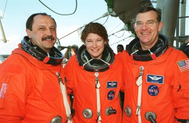 STS-102 Mission Specialists Yury Usachev (left), Susan Helms (center) and James Voss (right) take time to pose for the camera after emergency escape training on the 195-foot level of the Fixed Service Structure, Launch Pad 39B. They are the Expedition Two crew who will be flying to the International Space Station on mission STS-102 to replace Expedition One. The STS-102 crew is at KSC for Terminal Countdown Demonstration Test activities, which include the emergency training and a simulated launch countdown. STS-102 is the eighth construction flight to the International Space Station, with Space Shuttle Discovery carrying the Multi-Purpose Logistics Module Leonardo. Expedition One will return to Earth with Discovery. Launch on mission STS-102 is scheduled for March 8