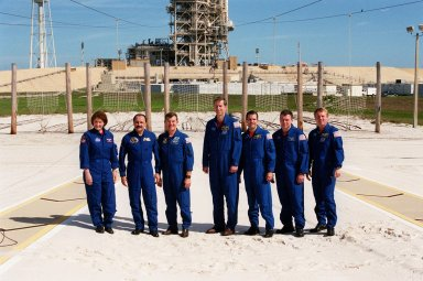 After a media briefing at the slidewire basket landing near Launch Pad 39B, the STS-102 crew poses for photographers. From left are Mission Specialists Susan Helms, Yury Usachev and James Voss; Commander James Wetherbee; Mission specialist Paul Richards; Pilot James Kelly; and Mission Specialist Andrew Thomas. The crew is taking part in Terminal Countdown Demonstration Test activities, which include emergency exit training from the pad and a simulated launch countdown. STS-102 is the eighth construction flight to the International Space Station, with Space Shuttle Discovery carrying the Multi-Purpose Logistics Module Leonardo. Voss, Helms and Usachev are the Expedition Two crew who will be the second resident crew on the International Space Station. They will replace Expedition One, who will return to Earth with Discovery. Launch on mission STS-102 is scheduled for March 8