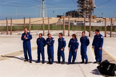 During Terminal Countdown Demonstration Test activities, the STS-102 crew takes time to talk to the media at the slidewire basket landing near Launch Pad 39B. With the microphone (left) is Commander James Wetherbee; the others are (left to right) Mission Specialists Yury Usachev, Andrew Thomas, James Voss, Susan Helms and Paul Richards; and Pilot James Kelly. STS-102 is the eighth construction flight to the International Space Station, with Space Shuttle Discovery carrying the Multi-Purpose Logistics Module Leonardo. Voss, Helms and Usachev are the Expedition Two crew who will be the second resident crew on the International Space Station. They will replace Expedition One, who will return to Earth with Discovery. Launch on mission STS-102 is scheduled for March 8