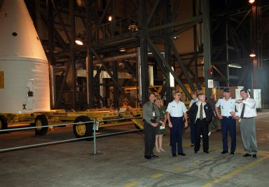 Dave King (far right), director of Shuttle Processing , explains part of the launch process to (from left) Dave Rainer; Brig. Gen. Donald Pettit, Commander of the 45th Space Wing, Cape Canaveral; Roy Bridges, KSC?s Center Director; and Gen. Ralph Everhart, Commander, Space Command , who are touring the Vehicle Assembly Building