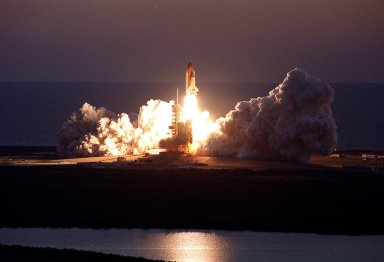 KENNEDY SPACE CENTER, Fla. -- Viewed from the top of the Vehicle Assembly Building, Space Shuttle Discovery leaps from the Earth against the background of the Atlantic Ocean on mission STS-102. Liftoff at dawn occurrred at 6:42:09 EST for the eighth flight to the International Space Station