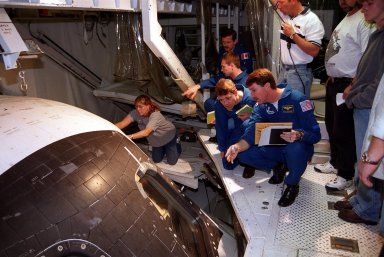 Members of the STS-100 crew check out Endeavour inside the Orbiter Processing Facility bay 2. In their blue uniforms, they are (front to back) Commander Kent V. Rominger, Pilot Jeff rey S. Ashby, and Mission Specialists Yuri Lonchakov, who is with the Russian Aviation and Space Agency, and Chris Hadfield, who is with the Canadian Space Agency. Other crew members at KSC for the CEIT are Mission Specialists Scott Parazynski and Umberto Guidoni, who is with the European Space Agency. Endeavour is carrying the Multi-Purpose Logistics Module Raffaello and the Canadian robotic arm, SSRMS, to the International Space Station. Raffaello carries six system racks and two storage racks for the U.S. Lab. Launch of mission STS-100 is scheduled for April 19 at 2:41 p.m. EDT from Launch Pad 39A