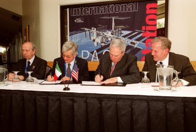 NASA Administrator Daniel S. Goldin and Italian Space Agency (ASI) President Sergio DeJulio sign a Framework for Cooperation to build the Habitation Module for the International Space Station. Seated at the table (left to right) are The Honorable Lamberto Dini, Minister of Foreign Affairs, Republic of Italy; DeJulio; Goldin; and John Schumacher, assistant administrator, External Relations, NASA. The Framework is a potential bilateral cooperative agreement that could result in ASI development of a U.S. Habitation Module for the International Space Station. This agreement allows the U.S. to explore an alternative approach to achieve full crew habitation for the ISS. A Memorandum of Understanding (MOU) between NASA and ASI will be required to formally document NASA and ASI?s respective responsibilities in a legally binding document. The Framework signed today would form the basis for a potential MOU which NASA and ASI would sign after completion of the program assessment and subsequent negotiations. The ceremony took place at the IMAX Theater, Kennedy Space Center Visitor Complex
