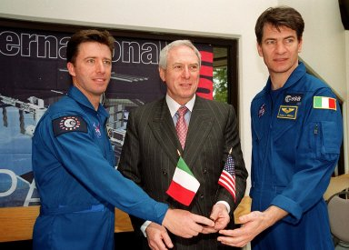 At a signing ceremony between the Italian Space Agency (ASI) and NASA for a Framework for Cooperation to build the Habitation Module for the International Space Station, Italian astronauts with the European Space Agency pose with NASA Administrator Daniel S. Goldin. On the left is Roberto Vittori and on the right is Paolo A. Nespoli. The Framework is a potential bilateral cooperative agreement that could result in ASI development of a U.S. Habitation Module for the International Space Station. This agreement allows the U.S. to explore an alternative approach to achieve full crew habitation for the ISS. A Memorandum of Understanding (MOU) between NASA and ASI will be required to formally document NASA and ASI?s respective responsibilities in a legally binding document. The Framework signed today would form the basis for a potential MOU which NASA and ASI would sign after completion of the program assessment and subsequent negotiations. The ceremony took place at the IMAX Theater, Kennedy Space Center Visitor Complex