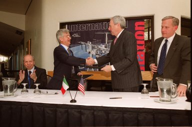 After signing a Framework for Cooperation to build the Habitation Module for the International Space Station, Italian Space Agency President Sergio DeJulio (standing, left) shakes hands with NASA Administrator Daniel S. Goldin (right). Also at the signing are The Honorable Lamberto Dini, Minister of Foreign Affairs, Republic of Italy (far left) and John Schumacher, assistant administrator, NASA External Relations. The Framework is a potential bilateral cooperative agreement that could result in ASI development of a U.S. Habitation Module for the International Space Station. This agreement allows the U.S. to explore an alternative approach to achieve full crew habitation for the ISS. A Memorandum of Understanding (MOU) between NASA and ASI will be required to formally document NASA and ASI?s respective responsibilities in a legally binding document. The Framework signed today would form the basis for a potential MOU which NASA and ASI would sign after completion of the program assessment and subsequent negotiations.The ceremony took place at the IMAX Theater, Kennedy Space Center Visitor Complex