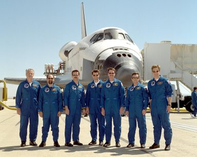 NASA/EDWARDS AFB, CALIF. -- After landing at Edwards Air Force Base, Calif., the STS-100 crew poses for a photograph in front of orbiter Endeavour, which successfully launched them to the International Space Station and returned them to Earth. They are (left to right) Mission Specialists John Phillips, Umberto Guidoni and Chris Hadfield; Pilot Jeffrey Ashby; Commander Kent Rominger; and Mission Specialists Yuri Lonchakov and Scott Parazynski. Guidoni is with the European Space Agency, Hadfield with the Canadian Space Agency and Lonchakov with the Russian Aviation and Space Agency. The orbiter and crew logged about 4.9 million statute miles in 186 orbits. Due to unfavorable weather conditions, landing at KSC was waved off. The landing marked the third consecutive landing at EAFB.