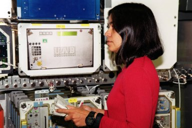 KENNEDY SPACE CENTER, Fla. -- During Crew Equipment Interface Test (CEIT)activities at SPACEHAB, Cape Canaveral, Fla., STS-107 Mission Specialist Kalpana Chawla looks over equipment inside the Spacehab module. As a research mission, STS-107 will carry the Spacehab Double Module in its first research flight into space and a broad collection of experiments ranging from material science to life science. The CEIT activities enable the crew to perform certain flight operations, operate experiments in a flight-like environment, evaluate stowage locations and obtain additional exposure to specific experiment operations. Other STS-107 crew members are Commander Rick Douglas Husband; Pilot William C. McCool; Payload Commander Michael P. Anderson; Mission Specialists Laurel Blair Salton Clark and David M. Brown; and Payload Specialist Ilan Ramon, of Israel. STS-107 is scheduled for launch May 23, 2002
