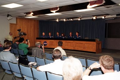 KENNEDY SPACE CENTER, Fla. -- The STS-104 crew responds to questions from the media in the television studio. Seated at far left is moderator Bill Johnson, NASA/KSC TV manager. Beside him, left to right, are Commander Steven W. Lindsey, Pilot Charles O. Hobaugh, and Mission Specialists Janet Lynn Kavandi, Michael L. Gernhardt and James F. Reilly. . The crew is taking part in Terminal Countdown Demonstration Test activities, which include emergency exit training from the orbiter, opportunities to inspect their mission payloads in the orbiter?s payload bay and simulated countdown exercises. The launch of Atlantis on mission STS-104 is scheduled July 12 from Launch Pad 39B. The mission is the 10th flight to the International Space Station and carries the Joint Airlock Module