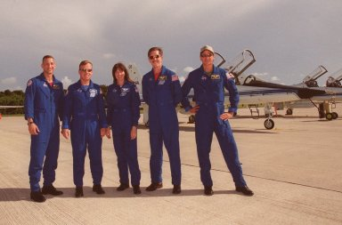 KENNEDY SPACE CENTER, Fla. -- The STS-104 crew pauses at the SLF after their arrival. Standing left to right are Pilot Charles O. Hobaugh, Commander Steven W. Lindsey and Mission Specialists Janet Lynn Kavandi, James F. Reilly and Michael L. Gernhardt. They are at KSC to take part in Terminal Countdown Demonstration Test (TCDT) Activities. The TCDT provides the crew with emergency egress training, opportunities to inspect their mission payloads in Space Shuttle Atlantis?s payload bay, and simulated countdown exercises. The launch of Atlantis on mission STS-104 is scheduled no earlier than July 12 from Launch Pad 39B. The mission is the 10th flight to the International Space Station and carries the Joint Airlock Module