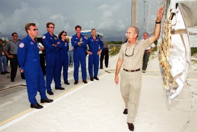 KENNEDY SPACE CENTER, Fla. -- During training at the launch pad, the STS-104 crew listen to instructions on use of the slidewire basket for emergency exit from the orbiter at the pad. Standing left to right are Commander Steven W. Lindsey, Mission Specialists Michael L. Gernhardt, Janet Lynn Kavandi and James F. Reilly, and Pilot Charles O. Hobaugh. The training is part of Terminal Countdown Demonstration Test activities, which also include opportunities to inspect their mission payloads in the orbiter?s payload bay and simulated countdown exercises. The launch of Atlantis on mission STS-104 is scheduled July 12 from Launch Pad 39B. The mission is the 10th flight to the International Space Station and carries the Joint Airlock Module