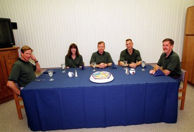 KENNEDY SPACE CENTER, Fla. -- The STS-104 crew finish their final meal of the day before launch. Seated from left are Mission Specialists Michael L. Gernhardt and Janet Lynn Kavandi, Commander Steven W. Lindsey, Pilot Charles O. Hobaugh and Mission Specialist James F. Reilly. The launch of Space Shuttle Atlantis on mission STS-104 is targeted for 5:04 a.m., July 12, from Launch Pad 39B. The primary payload on the mission is the joint airlock module, which will be added to the International Space Station. The airlock will be the primary path for Space Station spacewalk entry and departure for U.S. spacesuits, and will also support the Russian Orlan spacesuit for EVA activity