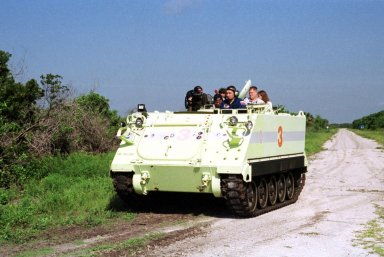 KENNEDY SPACE CENTER, Fla. -- Expedition Three crew member Vladimir Nikolaevich Dezhurov drives M-113 armored personnel carrier that is part of emergency egress training at the pad. The training is part of Terminal Countdown Demonstration Test activities, which also include a simulated launch countdown and familiarization with the payload. Other crew members taking part are the STS-105 crew, Commander Scott Horowitz, Pilot Rick Sturckow, Mission Specialists Daniel Barry and Patrick Forrester; and the rest of Expedition Three, Commander Frank Culbertson and Mikhail Tyurin. Mission STS-105 will be transporting the Expedition Three crew, several payloads and scientific experiments to the International Space Station aboard Space Shuttle Discovery. The current Expedition Two crew members on the Station will return to Earth on Discovery. Launch of Discovery is scheduled no earlier than Aug. 9, 2001