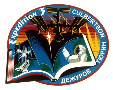 "JOHNSON SPACE CENTER, HOUSTON, TEXAS -- EXPEDITION THREE INSIGNIA -- The Expedition Three crew members -- astronaut Frank L. Culbertson Jr., commander, and cosmonauts Vladimir N. Dezhurov and Mikhail Tyurin -- had the following to say about the insignia for their scheduled mission aboard the International Space Station (ISS): ""The book of space history turns from the chapter written onboard the Russian Mir Station and the U.S. Space Shuttle to the next new chapter, one that will be written on the blank pages of the future by space explorers working for the benefit of the entire world. The space walker signifies the human element of this endeavor. The star representing the members of the third expedition, and the entire multi-national Space Station building team, streaks into the dawning era of cooperative space exploration, represented by the image of the International Space Station as it nears completion."" The insignia design for ISS flights is reserved for use by the astronauts and cosmonauts and for other official use as the NASA Administrator and NASA's international partners may authorize. Public availability has been approved only in the form of illustrations by the various news media. When and if there is any change in this policy, which we do not anticipate, it will be publicly announced"