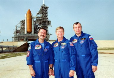 KENNEDY SPACE CENTER, Fla. -- The Expedition Three crew poses in front of Space Shuttle Discovery on Launch Pad 39A. From left are cosmonauts Mikhail Tyurin and Vladimir Nikolaevich Dezhurov and Commander Frank Culbertson. Along with the STS-105 crew, they are taking part in Terminal Countdown Demonstration Test activities, which include emergency egress from the pad, a simulated launch countdown and familiarization with the payload. Mission STS-105 will be transporting the Expedition Three crew, several payloads and scientific experiments to the International Space Station aboard Discovery. The current Expedition Two crew members on the Station will return to Earth on Discovery. Launch of Discovery is scheduled no earlier than Aug. 9, 2001