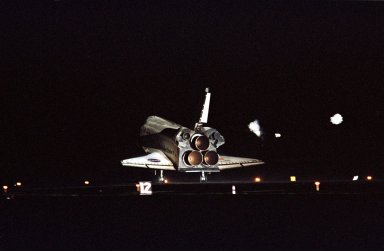 KENNEDY SPACE CENTER, Fla. -- The lights on Runway 15 at KSC?s Shuttle Landing Facility spotlight Atlantis as it touches down, completing a 12-day, 18-hour, 34-minute-long STS-104 mission. Main gear touchdown occurred at 11:38:55 p.m. EDT. At the controls is Commander Steven W. Lindsey. Other crew members on board are Pilot Charles Hobaugh and Mission Specialists Michael Gernhardt, Janet Lynn Kavandi and James F. Reilly. This is the 18th nighttime landing for a Space Shuttle, the 13th at Kennedy Space Center. The mission delivered the Joint Airlock Module to the International Space Station, which was subsequently attached to the Unity Node, completing the second phase of the assembly of the Space Station