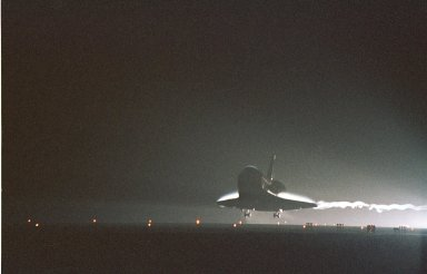 KENNEDY SPACE CENTER, Fla. -- Silhouetted against the bright lights at the Shuttle Landing Facility, Atlantis prepares to land on Runway 15 at the Shuttle Landing Facility to complete a 12-day, 18-hour, 34-minute-long STS-104 mission. Main gear touchdown occurred at 11:38:55 p.m. EDT. At the controls is Commander Steven W. Lindsey. Other crew members on board are Pilot Charles Hobaugh and Mission Specialists Michael Gernhardt, Janet Lynn Kavandi and James F. Reilly. This is the 18th nighttime landing for a Space Shuttle, the 13th at Kennedy Space Center. The mission delivered the Joint Airlock Module to the International Space Station, completing the second phase of the assembly of the Space Station