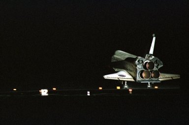 KENNEDY SPACE CENTER, Fla. -- Atlantis touches down on KSC?s Runway 15 as Atlantis completes a 12-day, 18-hour, 34-minute-long STS-104 mission. Main gear touchdown occurred at 11:38:55 p.m. EDT. At the controls is Commander Steven W. Lindsey. Other crew members on board are Pilot Charles Hobaugh and Mission Specialists Michael Gernhardt, Janet Lynn Kavandi and James F. Reilly. This is the 18th nighttime landing for a Space Shuttle, the 13th at Kennedy Space Center. The mission delivered the Joint Airlock Module to the International Space Station, which was subsequently attached to the Unity Node, completing the second phase of the assembly of the Space Station