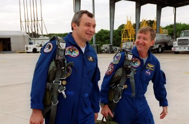 KENNEDY SPACE CENTER, Fla. -- Expedition Three crew members cosmonaut Vladimir Dezhurov (left) and Commander Frank Culbertson (right) walk to their T-38 jets for their morning training flights. The Expedition Three and STS-105 crews are preparing for launch on Aug. 9. On mission STS-105, Discovery will be transporting the Expedition Three crew and several payloads and scientific experiments to the Space Station. The Early Ammonia Servicer (EAS) tank, which contains spare ammonia for the Station?s cooling system and will support the thermal control subsystems until a permanent system is activated, will be attached to the Station during two spacewalks. The three-member Expedition Two crew will be returning to Earth aboard Discovery after a five-month stay on the Station