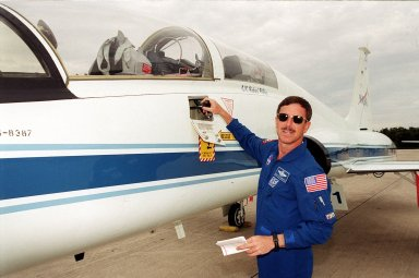KENNEDY SPACE CENTER, Fla. -- STS-105 Commander Scott Horowitz checks over the T-38 before a morning training flight. Horowitz and the STS-105 crew are preparing for launch on Aug. 9. On mission STS-105, Discovery will be transporting the Expedition Three crew and several payloads and scientific experiments to the Space Station. The Early Ammonia Servicer (EAS) tank, which contains spare ammonia for the Station?s cooling system and will support the thermal control subsystems until a permanent system is activated, will be attached to the Station during two spacewalks. The three-member Expedition Two crew will be returning to Earth aboard Discovery after a five-month stay on the Station