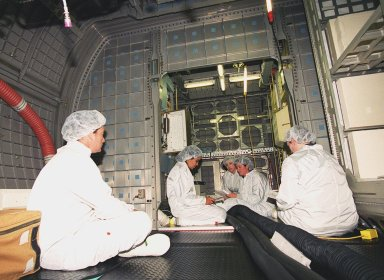 KENNEDY SPACE CENTER, Fla. -- At SPACEHAB, Cape Canaveral, members of the STS-107 crew look over elements in the SPACEHAB Double Module as part of equipment familiarization for their mission. The crew comprises Commander Rick Husband, Pilot William McCool, Payload Commander Michael Anderson, Mission Specialists Kalpana Chawla, David Brown and Laurel Clark, and Payload Specialist Ilan Ramon. STS-107 has two payload elements, the Double Module in its first flight into space and a Hitchhiker payload. The double module provides greater experiment capability than on previous flights, resulting for this mission in a very broad collection of experiments for NASA and commercial and European customers. The experiments range from material sciences to life sciences (many rats). The Hitchhiker carrier system is modular and expandable in accordance with payload requirements, which allows maximum efficiency in utilizing orbiter resources and increases the potential for early manifesting on the Shuttle. Hitchhiker experiments are housed in canisters or attached to mounting plates. The Hitchhiker canister comes in two varieties--the Hitchhiker Motorized Door Canister and the Sealed Canisters. STS-107 is scheduled to launch in May 2002