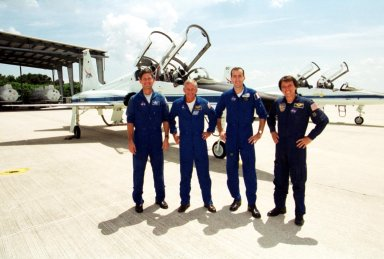 """KENNEDY SPACE CENTER, Fla. -- The STS-111 crew pause before departing KSC for Houston. The crew spent time in the Space Station Processing Facility for training on the payload they will be transporting: The Mobile Base System (MBS). Standing left to right are Pilot Paul Lockhart, Commander Ken Cockrell and Mission Specialists Phillippe Perrin, with the French space agency CNES, and Franklin Chang-Diaz. During the mission, the MBS will be installed on the Mobile Transporter to complete the Canadian Mobile Servicing System, or MSS. The mechanical arm will then have the capability to """"inchworm"""" from the U.S. Lab Destiny to the MSS and travel along the Truss to work sites. The Expedition Five crew will be replacing Expedition Four. Launch of Endeavour on mission STS-111 is scheduled for April 18, 2002"""