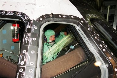 KENNEDY SPACE CENTER, Fla. -- During Crew Equipment Interface Test (CEIT) activities at KSC, STS-108 Pilot Mark E. Kelly checks the windshield inside orbiter Endeavour. The CEIT provides familiarization with the launch vehicle and payload. Mission STS-108 is a Utilization Flight (UF-1), carrying the Expedition Four crew plus Multi-Purpose Logistics Module Raffaello to the International Space Station. The mission crew comprises Commander Dominic L. Gorie, Kelly and Mission Specialists Linda A. Godwin and Daniel M. Tani. The Expedition Four crew comprises Yuri Onufriyenko, commander, Russian Aviation and Space Agency, and astronauts Daniel W. Bursch and Carl E. Walz. Endeavour is scheduled to launch Nov. 29 on mission STS-108