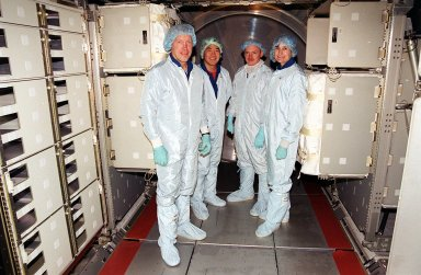 KENNEDY SPACE CENTER, Fla. -- The STS-108 crew pause during their checkout of the Multi-Purpose Logistics Module Raffaello. From left are Commander Dominic L. Gorie, Mission Specialist Daniel M. Tani, Pilot Mark E. Kelly and Mission Specialist Linda A. Godwin. The four astronauts are taking part in Crew Equipment Interface Test (CEIT) activities at KSC. The CEIT provides familiarization with the launch vehicle and payload. Mission STS-108 is a Utilization Flight (UF-1), carrying the Expedition Four crew plus Multi-Purpose Logistics Module Raffaello to the International Space Station. The Expedition Four crew comprises Yuri Onufriyenko, commander, Russian Aviation and Space Agency, and astronauts Daniel W. Bursch and Carl E. Walz. Endeavour is scheduled to launch Nov. 29 on mission STS-108