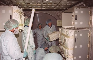 KENNEDY SPACE CENTER, Fla. -- The STS-108 crew practices moving packages in storage inside the the Multi-Purpose Logistics Module Raffaello. Holding a package is Commander Dominic L. Gorie. Kneeling below him (center) is Mission Specialist Linda A. Godwin. The crew is taking part in Crew Equipment Interface Test (CEIT) activities at KSC. Not seen are Pilot Mark E. Kelly and Mission Specialist Daniel M. Tani. The CEIT provides familiarization with the launch vehicle and payload. Mission STS-108 is a Utilization Flight (UF-1), carrying the Expedition Four crew plus Multi-Purpose Logistics Module Raffaello to the International Space Station. The Expedition Four crew comprises Yuri Onufriyenko, commander, Russian Aviation and Space Agency, and astronauts Daniel W. Bursch and Carl E. Walz. Endeavour is scheduled to launch Nov. 29 on mission STS-108